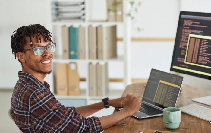 Man programming at desk